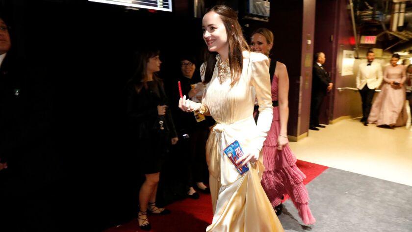 Dakota Johnson backstage at the 89th Academy Awards