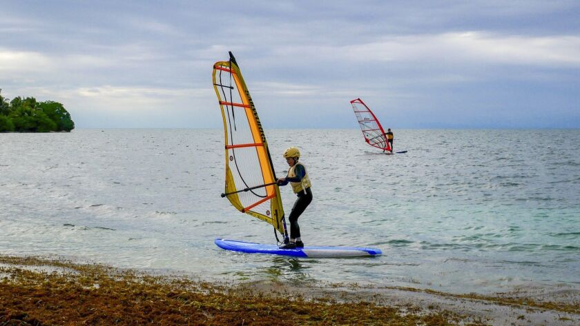 Liam Waring, the writer's 11-year-old son, windsurfs for the first time.
