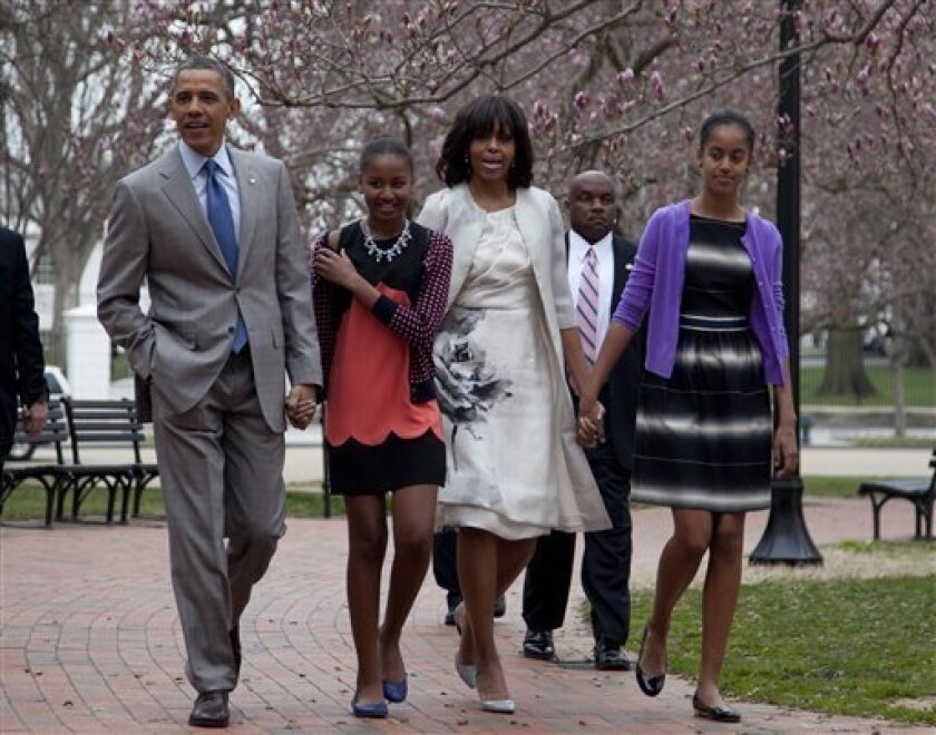 President Barack Obama and first lady Michelle Obama walk from the White House with their daughters Sasha Obama, second from left, and Malia Obama, right, on their way through Lafayette Park to St. John's Episcopal Church for Easter services, Sunday, March 31, 2013, in Washington. (AP Photo/Carolyn