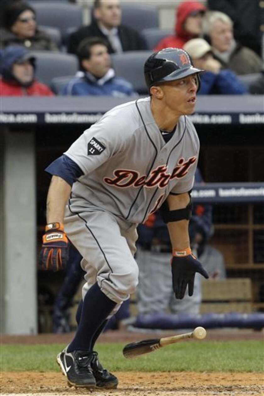 Detroit Tigers' Brandon Inge watches his fly out to New York Yankees center fielder Curtis Granderson during the ninth inning of an opening day baseball game at Yankee Stadium on Thursday, March 31, 2011 in New York. The Yankees won 6-3.  (AP Photo/Kathy Willens)