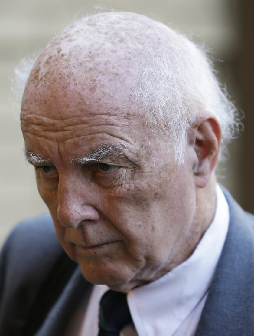 Retired tennis player Bob Hewitt arrives for his sentencing at the high court in Pretoria, South Africa, Monday, May 18, 2015.  Hewitt, a former Grand Slam doubles tennis champion, was convicted in South African court of rape and sexual assault decades after the alleged assaults, and sentenced to s