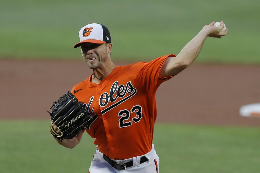 Baltimore Orioles starting pitcher Wade LeBlanc throws a pitch to the Tampa Bay Rays during the first inning of a baseball game, Saturday, Aug. 1, 2020, in Baltimore. (AP Photo/Julio Cortez)
