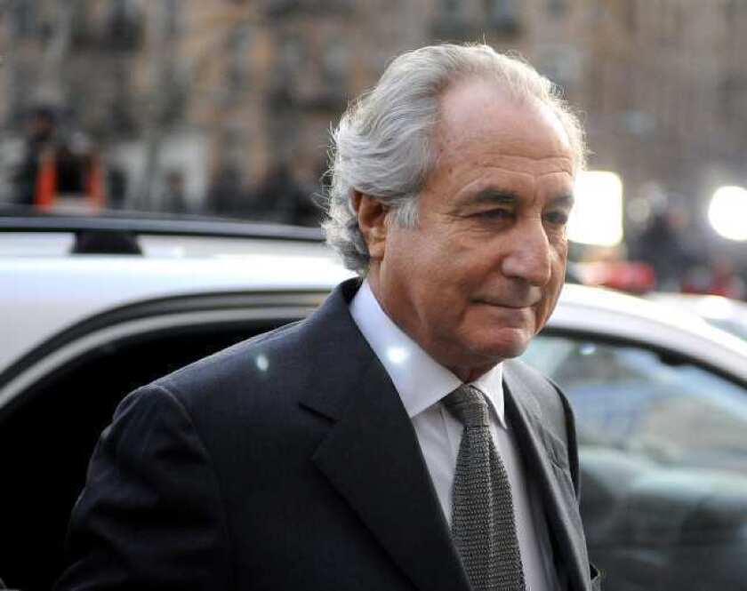 Bernard Madoff arrives at Manhattan federal court on March 12, 2009. His family members and daughters-in-law have been sued for more than $255 million.