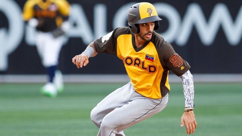 The World Team's Carlos Asuaje looks back before running to third base in the ninth inning during the All-Star Futures Game at Petco Park in San Diego on Sunday.