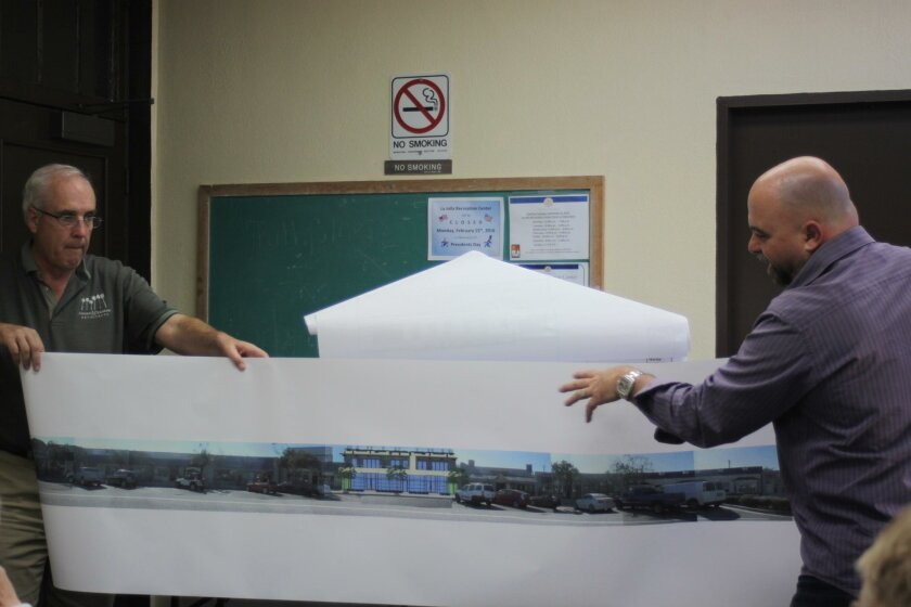 Bird Rock mixed-use project applicant Claude-Anthony Marengo (right) shows a rendering to illustrate how his project fits with surrounding buildings.