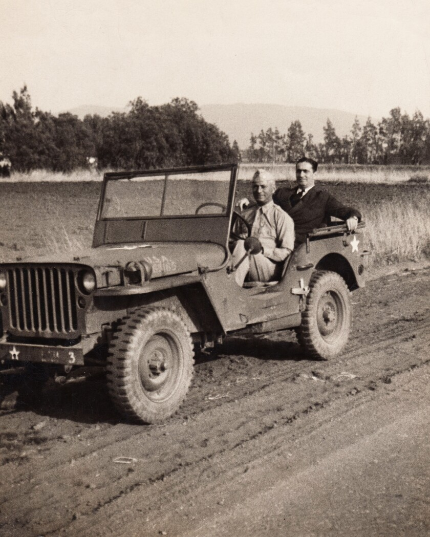 World War II spy Moe Berg, shown in a military jeep driven by his brother Sam in 1942, played 15 MLB seasons.