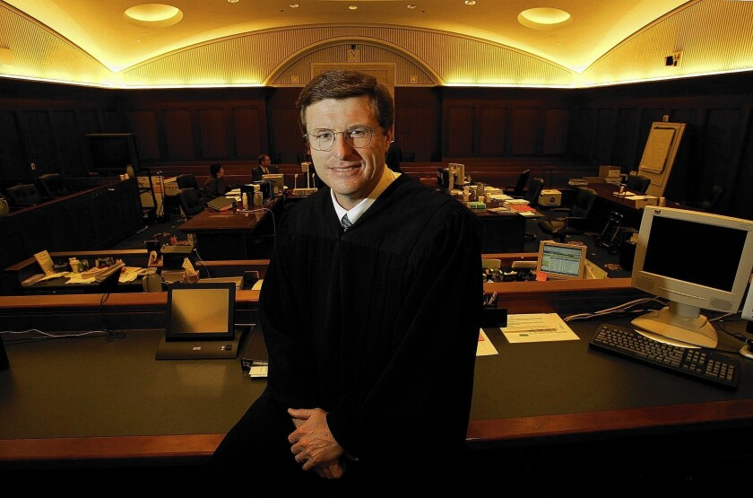 U.S. District Judge Cormac J. Carney poses in a courtroom