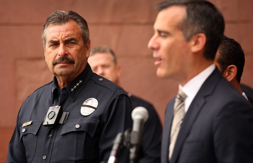 Los Angeles Mayor Eric Garcetti, right, with LAPD Chief Charlie Beck, left, during a press conference at LAPD Mission Division on September 4.