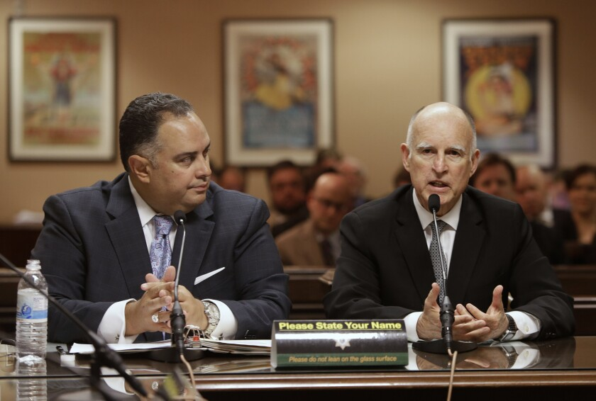 Gov. Jerry Brown discusses a proposed rainy-day-fund plan alongside John A. Perez (D-Los Angeles), then the Assembly speaker, in April.