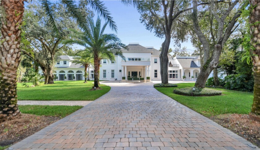 The 18,700-square-foot mansion includes nine bedrooms, 13 bathrooms, a movie theater, wine cellar, cigar room and indoor pool.