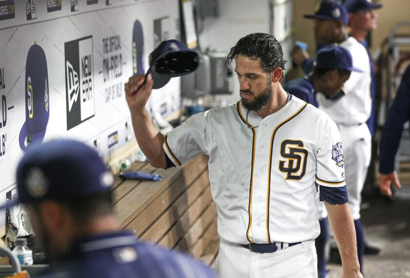 The Padres' starting pitcher James Shields throws his cap down in the dugout after being taken out of the game against the Giants in the seventh inning at Petco Park in San Diego on Thursday.