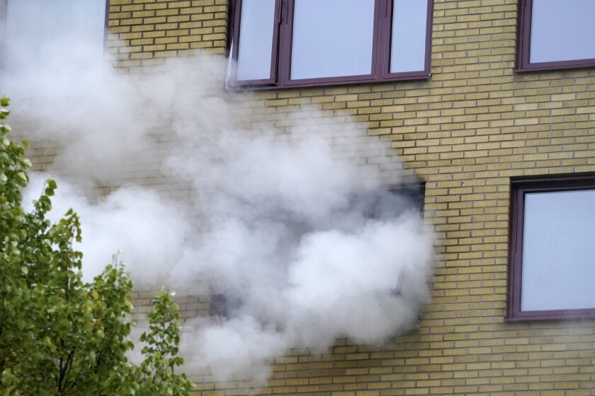 Smoke billows from an apartment building after an explosion in Annedal, central Gothenburg, Sweden, Tuesday Sept. 28, 2021. A powerful explosion in an apartment building in Sweden's second-largest city has injured up to 20 people and forced the evacuation of hundreds more. A police spokesperson said eight people were taken to the hospital and the cause of the explosion was not yet known. (Bjorn Larsson Rosvall/TT via AP)