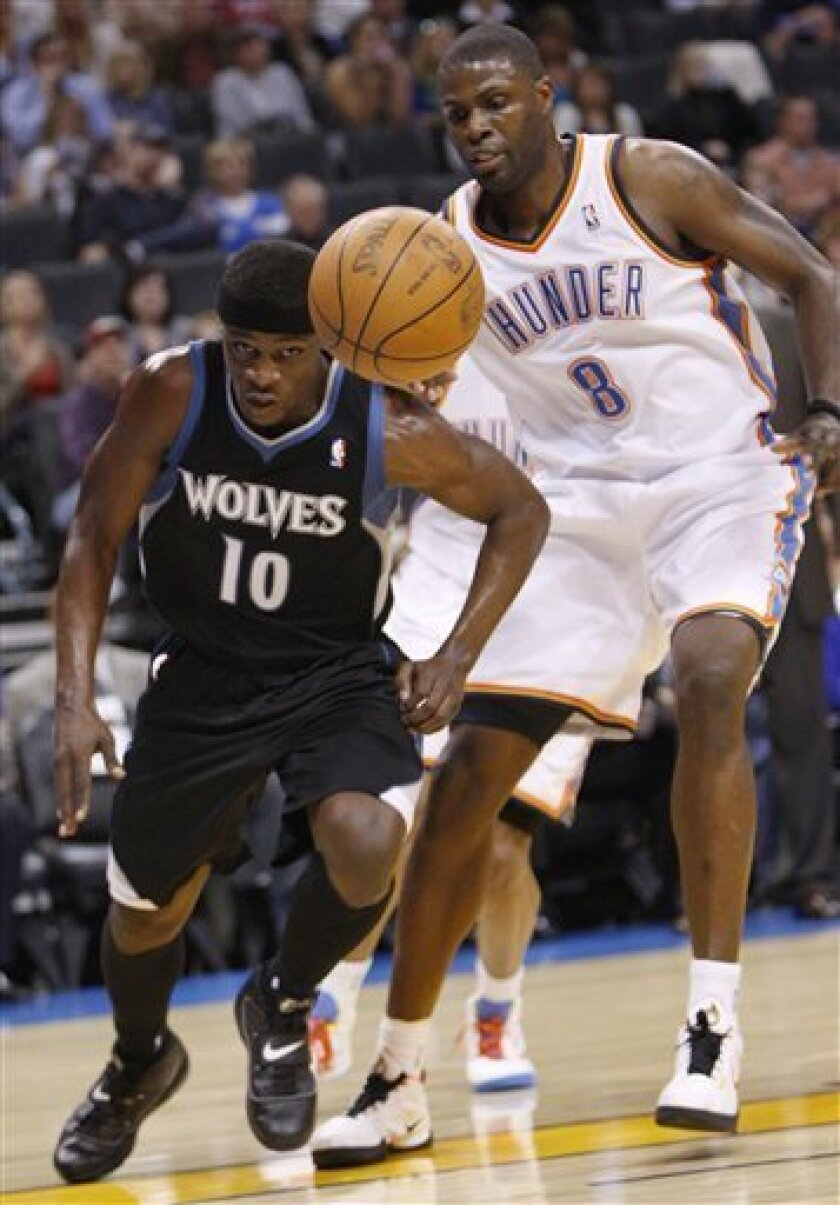 Minnesota Timberwolves guard Jonny Flynn, left, and Oklahoma City Thunder center Nazr Mohammed, right, chase a loose ball in the second quarter of an NBA basketball game in Oklahoma City, Friday, March 25, 2011. (AP Photo/Sue Ogrocki)