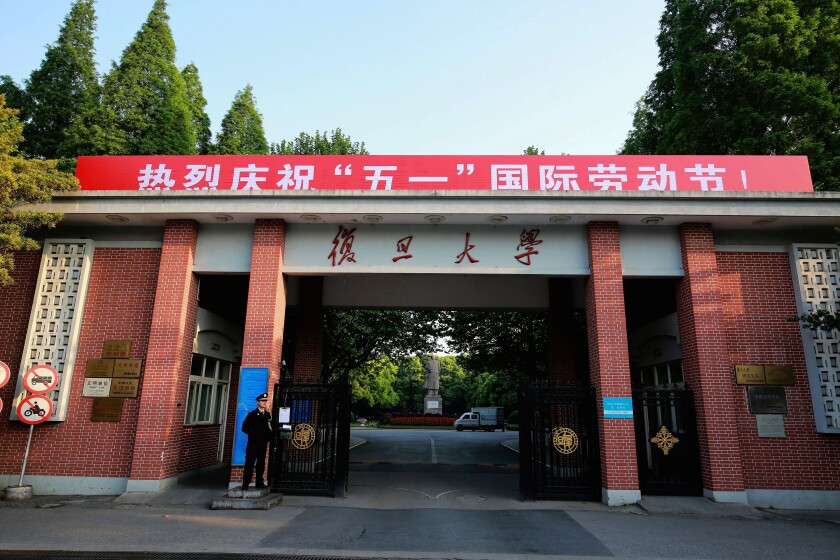 A security guard stands at the gate to the campus of Fudan University in Shanghai, China on on April 28, 2017. A professor killed the Communist Party secretary at the school of mathematics at China's prestigious Fudan University on Monday, June 7, 2021, police and school authorities said. (Chinatopix via AP)