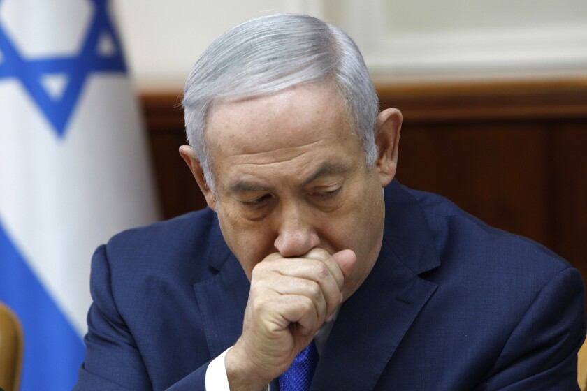 Israeli Prime Minister Benjamin Netanyahu attends the weekly cabinet meeting at his office in Jerusalem on Sunday.