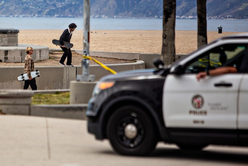LAPD clears people from using the skate park at Venice Beach during the coronavirus pandemic on Monday in Venice Beach.