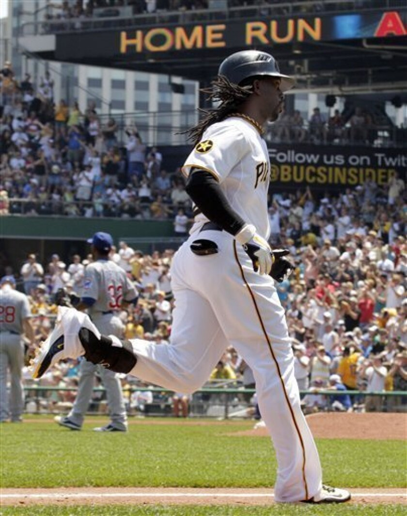 Pittsburgh Pirates' Andrew McCutchen rounds third base after hitting a three-run homer in the third inning of a baseball game in Pittsburgh Sunday, July 10, 2011. (AP Photo/Gene J. Puskar)