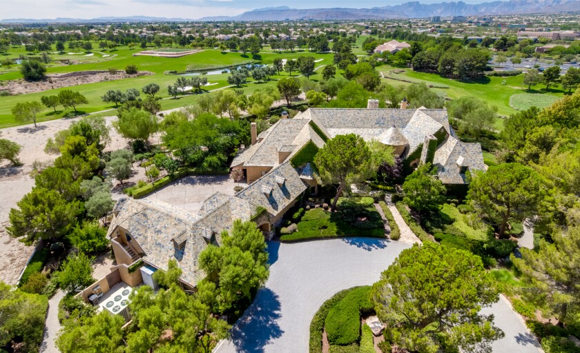 Set on 2.6 acres, the golf course estate centers on a French-inspired mansion with Old World details across more than 14,000 square feet.