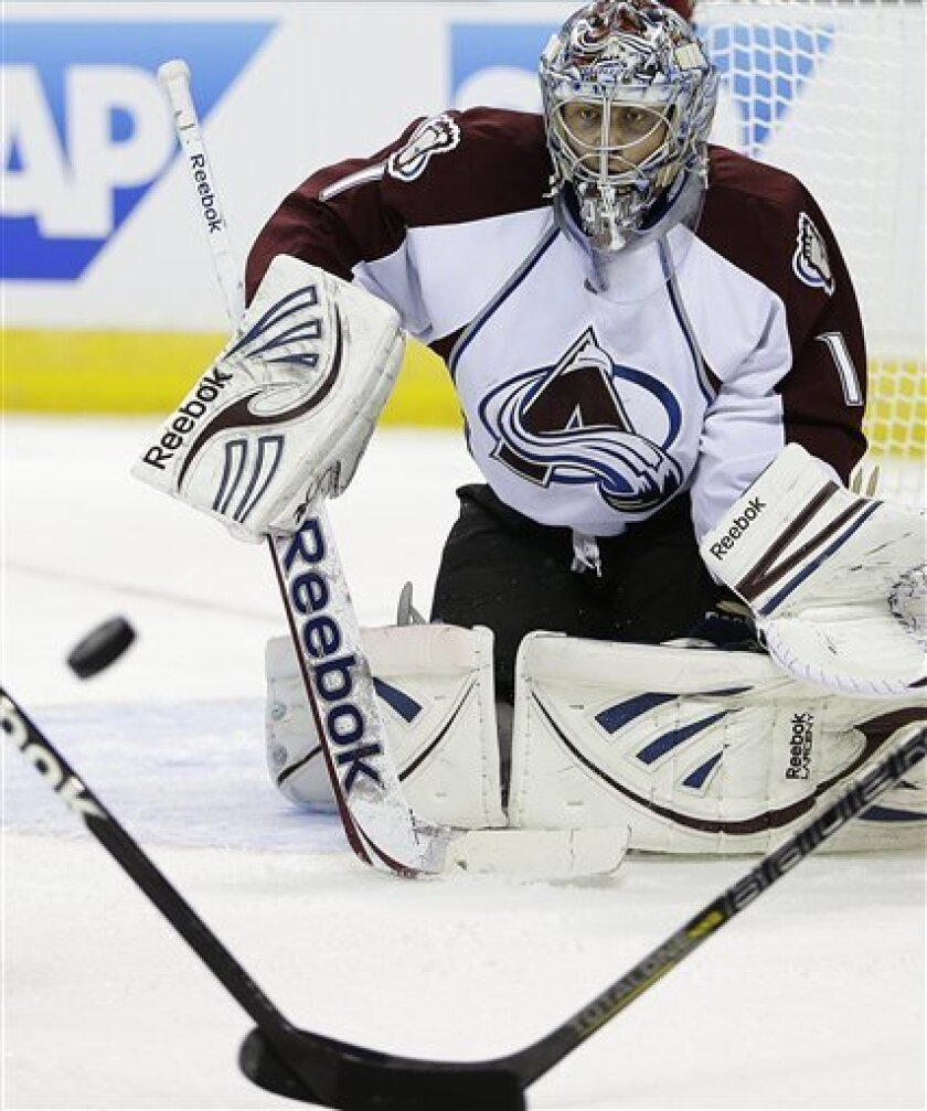 CORRECTS MONTH TO FEBRUARY, NOT MARCH - Colorado Avalanche goalie Semyon Varlamov eyes the puck during the first period of an NHL hockey game against the San Jose Sharks, Tuesday, Feb. 26, 2013, in San Jose, Calif. (AP Photo/Ben Margot)