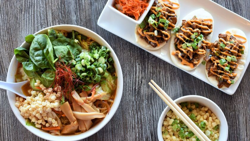 Three stand-out dishes at Blvd Noodles are the ramen, the miso corn salad and the bao bun tacos