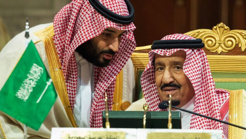 Saudi Crown Prince Mohammed bin Salman, left, speaks to his father, King Salman, at a meeting of the Gulf Cooperation Council in Riyadh, Saudi Arabia on Dec. 9.