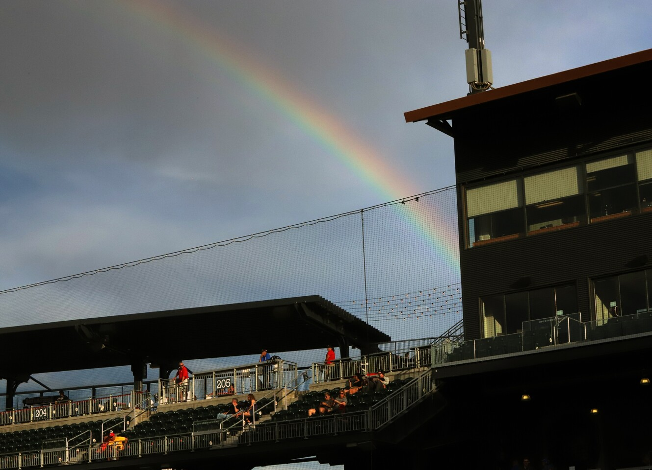 A rainbow appears over the grand stands at Southwest University Park during a minor league baseball game Wednesday, August 7 in El Paso, TX.