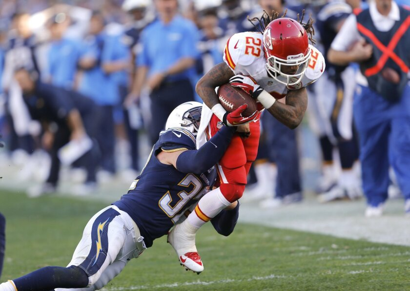 Chargers safety Eric Weddle tackles Chiefs wide receiver Dexter McCluster as the Chargers took on the Kansas City Chiefs at Qualcomm Stadium Sunday afternoon.