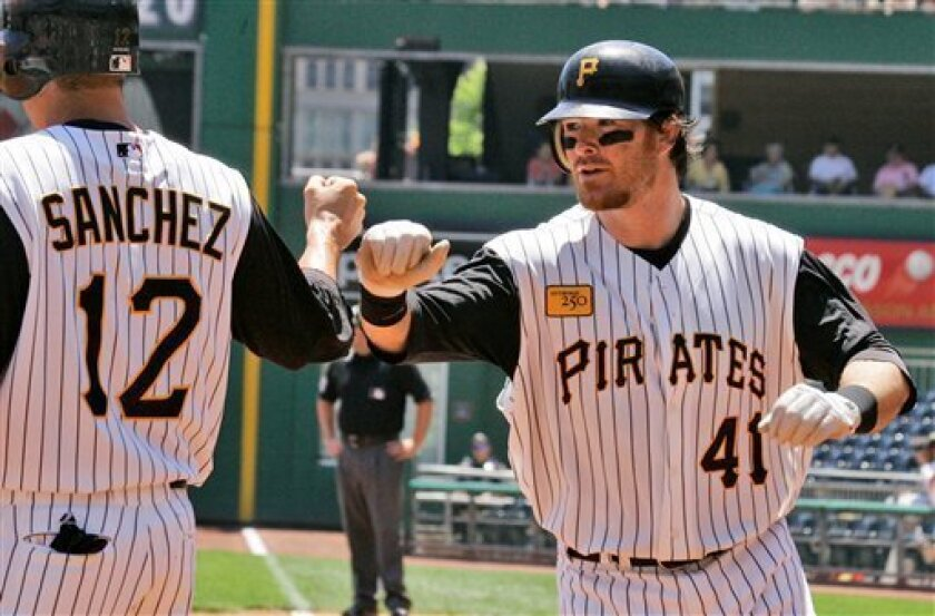 Pittsburgh Pirates' Ryan Doumit (41) is greeted by teammate Freddy Sanchez (12) who was on base for his first inning two-run homer off Washington Nationals pitcher Jason Bergmann in a baseball game at Pittsburgh Thursday, June 12, 2008. The Pirates won 7-5.(AP Photo/Gene J. Puskar)