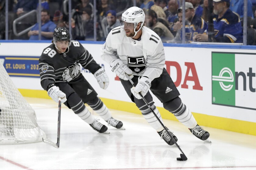 The Kings' Anze Kopitar handles the puck for the Pacific Division team as the Blackhawks' Patrick Kane of the Central Division trails Jan. 25, 2020.