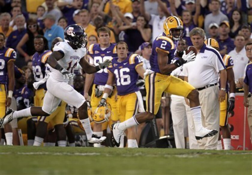 LSU wide receiver Rueben Randle (2) runs with a pass reception as Northwestern State safety Bert White (10) pursues during the first quarter of an NCAA college football game in Baton Rouge, La., Saturday, Sept. 10, 2011. (AP Photo/Gerald Herbert)