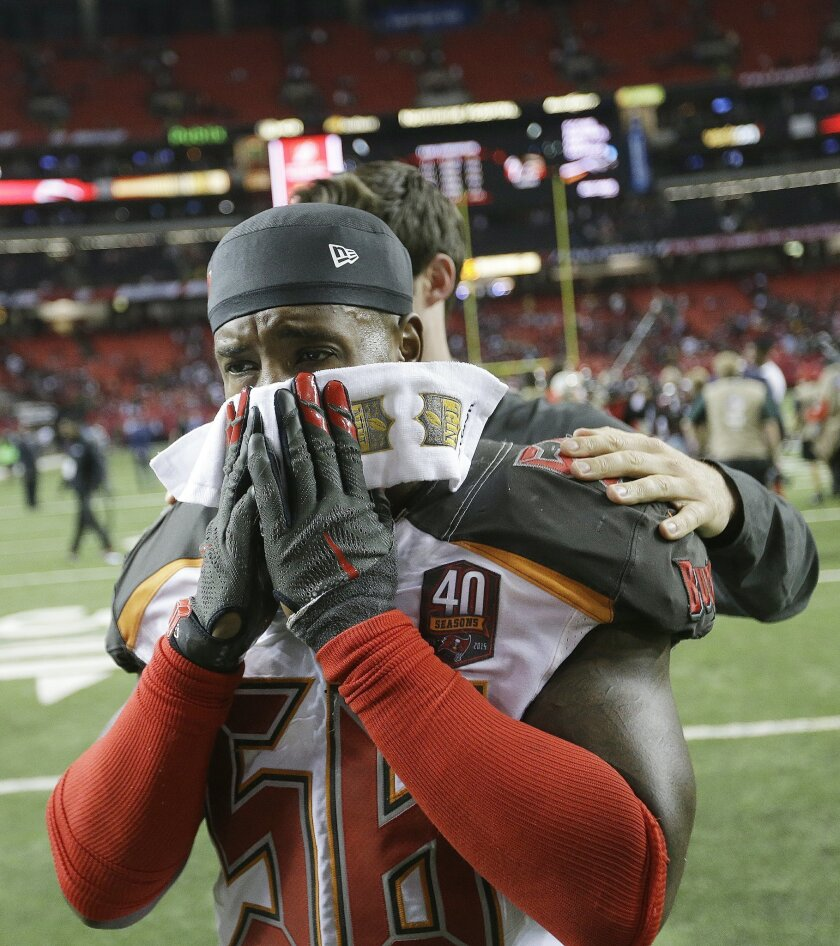 Tampa Bay Buccaneers middle linebacker Kwon Alexander walks off the field after overtime of an NFL football game against the Atlanta Falcons, Sunday, Nov. 1, 2015, in Atlanta. The Tampa Bay Buccaneers won 23-20. (AP Photo/David Goldman)