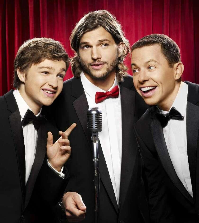"Angus T. Jones, left, Ashton Kutcher and Jon Cryer star in ""Two and a Half Men."""