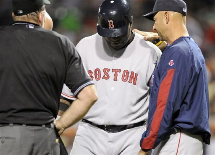 Boston Red Sox manager Terry Francona, right, talks to Red Sox's David Ortiz, center, before pulling him out of the game because of a hand injury in the ninth inning of a baseball game against the Baltimore Orioles, Saturday, May 31, 2008, at Oriole Park at Camden Yards in Baltimore. (AP Photo/ Steve Ruark)