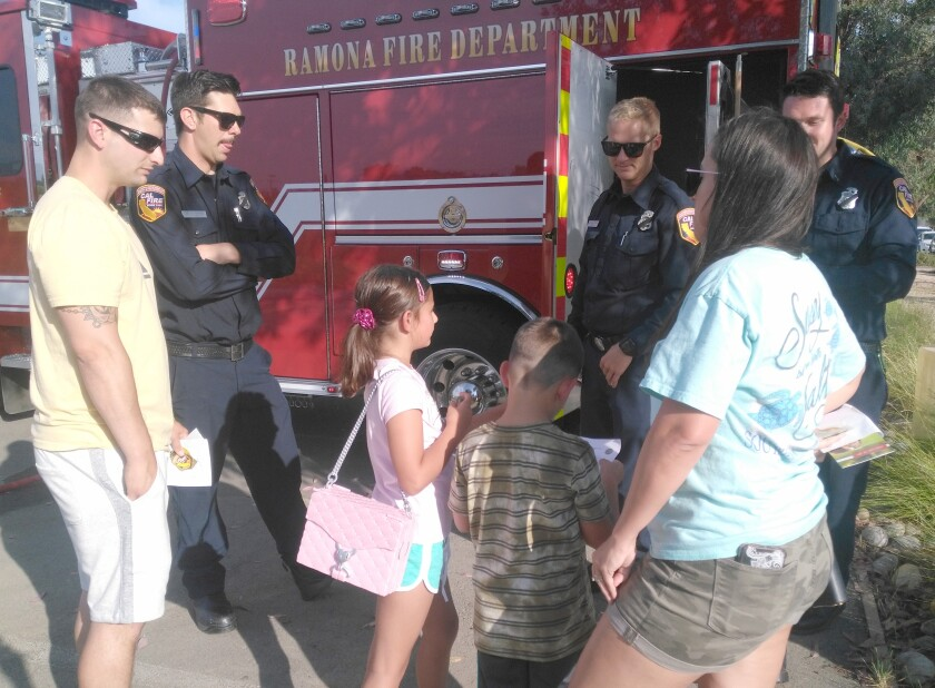 Copy - Firefighters Talking to Family.jpg