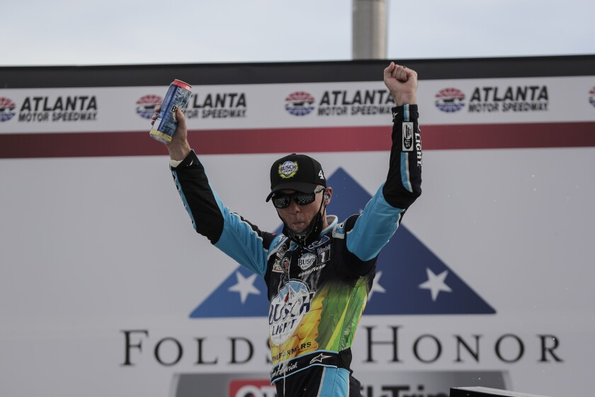 Kevin Harvick celebrates after winning a NASCAR Cup race at Atlanta Motor Speedway.