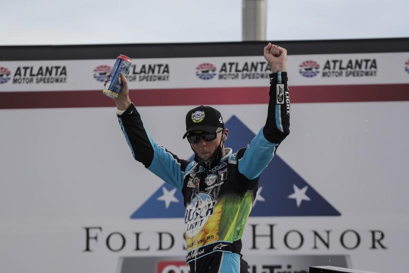 Kevin Harvick celebrates after winning a NASCAR Cup race at Atlanta Motor Speedway.