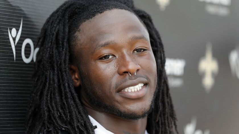 New Orleans Saints running back Alvin Kamara talks reporters during training camp at their NFL footb
