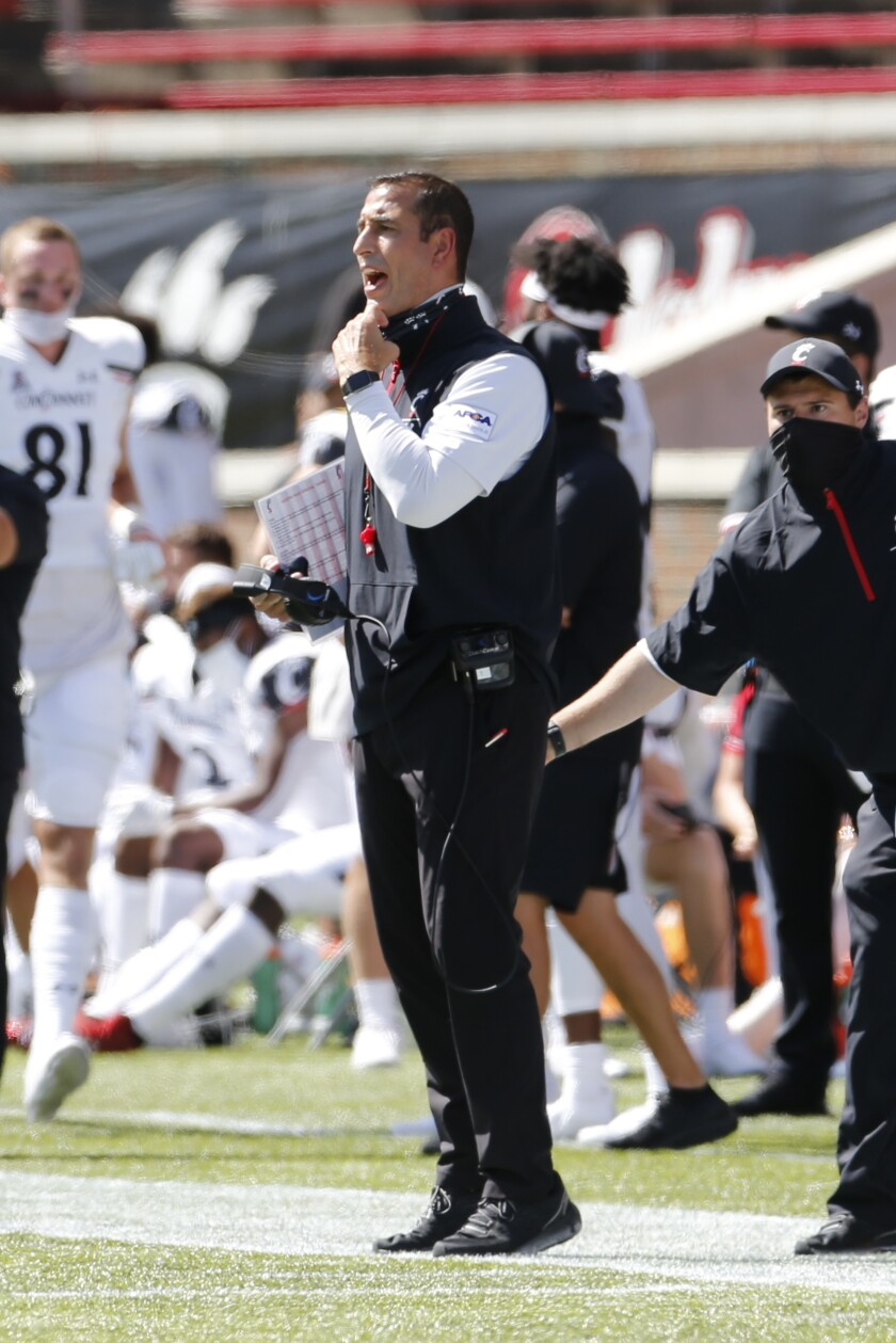 Cincinnati head coach Luke Fickell shouts to his team against Austin Peay during the first half of an NCAA college football game Saturday, Sept. 19, 2020, in Cincinnati, Ohio. Cincinnati beat Austin Peay 55-20. (AP Photo/Jay LaPrete)