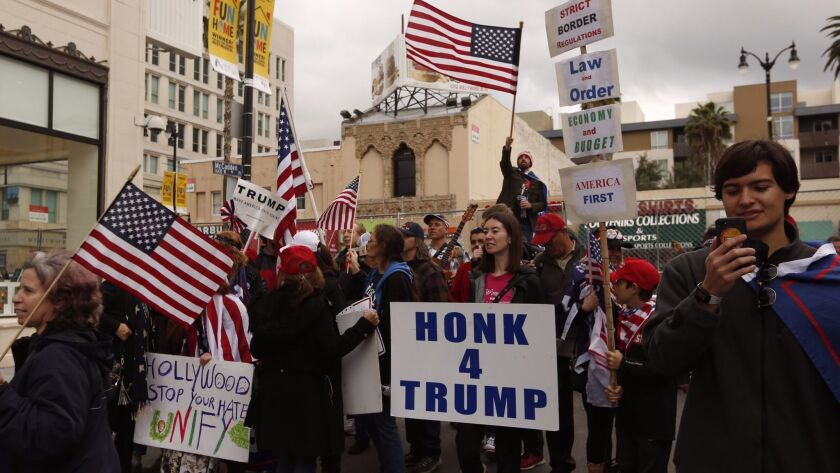 Members of the group San Fernando Valley For Trump Celebration and others rally near the Dolby Theatre in support of the president.