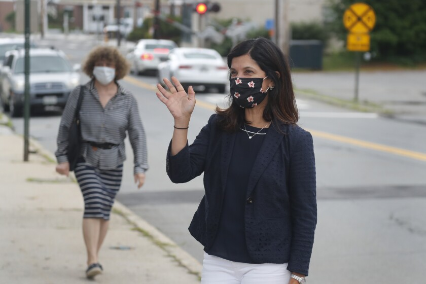 Sara Gideon waves Tuesday in Portland, Maine, before winning the Democratic nomination to challenge GOP Sen. Susan Collins.