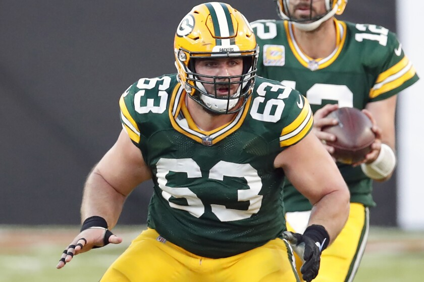 Green Bay Packers center Corey Linsley (63) blocks for quarterback Aaron Rodgers.