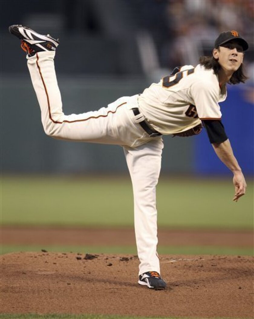 San Francisco Giants starter Tim Lincecum follows through on a pitch during to the Atlanta Braves during the first inning of Game 1 of baseball's National League Division Series in San Francisco, Thursday, Oct. 7, 2010. (AP Photo/Ezra Shaw, pool)
