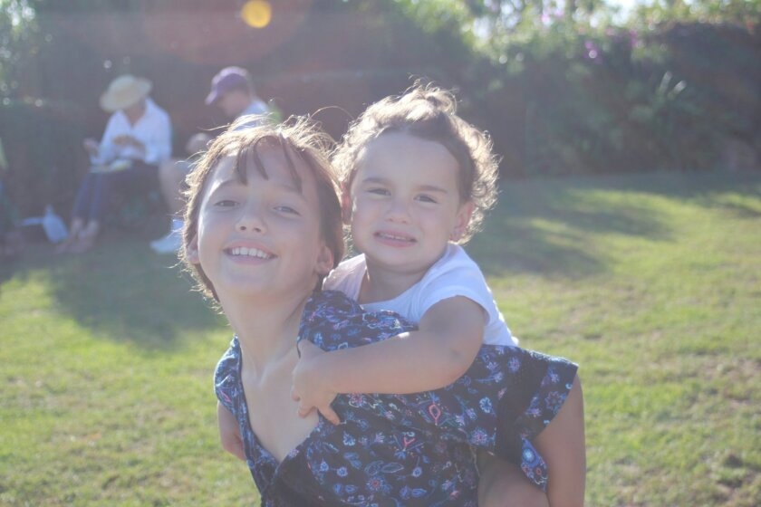 Sophia Parker gives a piggyback ride to her little cousin Brixton Sillman.