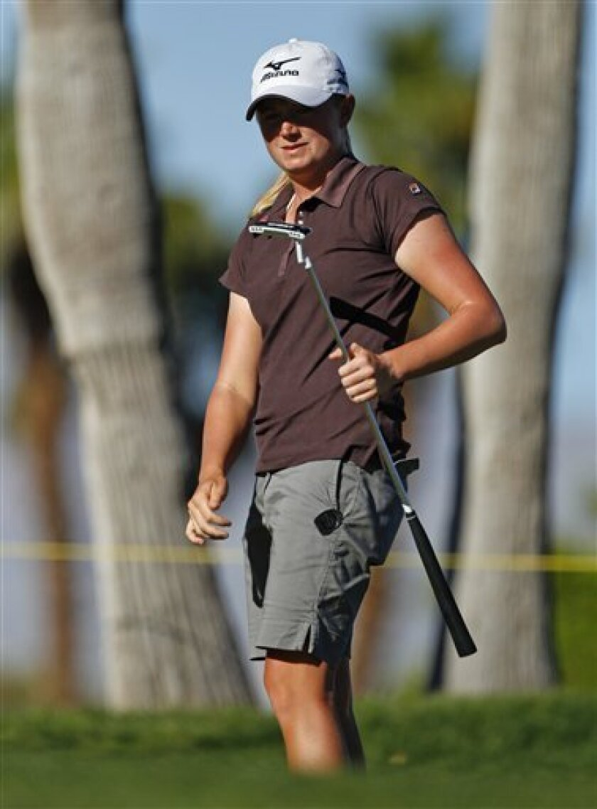 Stacy Lewis watches her putt on the eighth green during the first round of the LPGA Kraft Nabisco Championship golf tournament in Rancho Mirage, Calif., Thursday, March 31, 2011. (AP Photo/Chris Carlson)