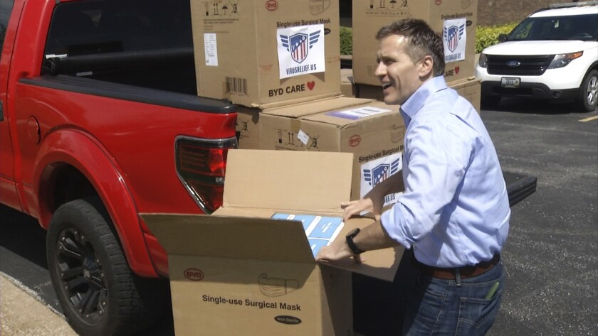 In this April 27, 2020 image from video provided by KRCG-TV, former Missouri Gov. Eric Greitens delivers masks to first responders in Columbia, Mo. Greitens passed out masks across the state in the early days of the coronavirus pandemic last spring. (KRCG-TV via The AP)