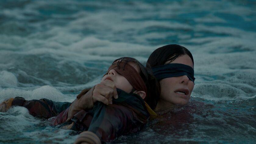 "Julian Edwards and Sandra Bullock in the popular Netflix thriller ""Bird Box."""