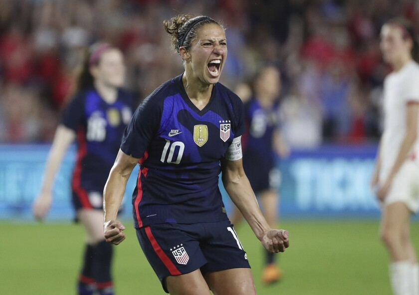 United States' Carli Lloyd celebrates after scoring a goal against England during a She Believes Cup soccer match in Orlando, Fla., Thursday, March 5, 2020. (Stephen M. Dowell/Orlando Sentinel via AP)