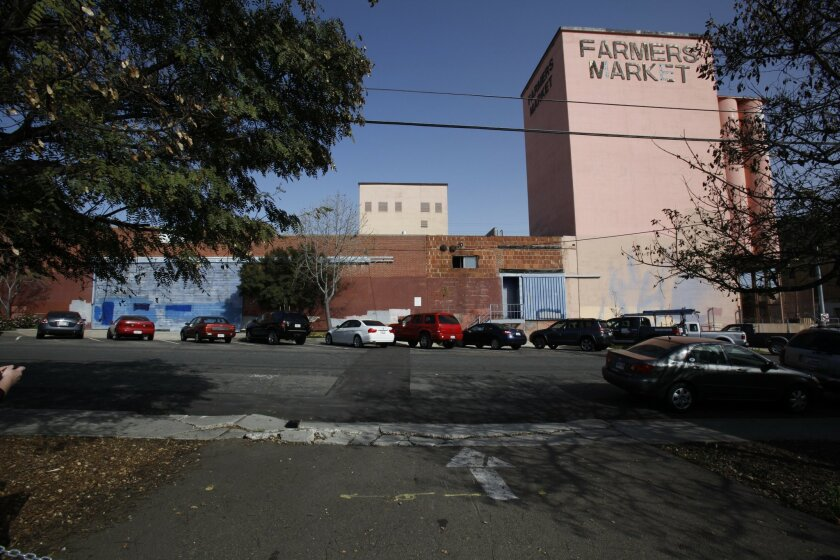The landmark San Diego Farmers Market building is being converted into Walmart's grocery-store concept, a Neighborhood Market. Community members and labor unions are asking for the retailer to agree to certain stipulations, such as hiring locally and investing in community programs.