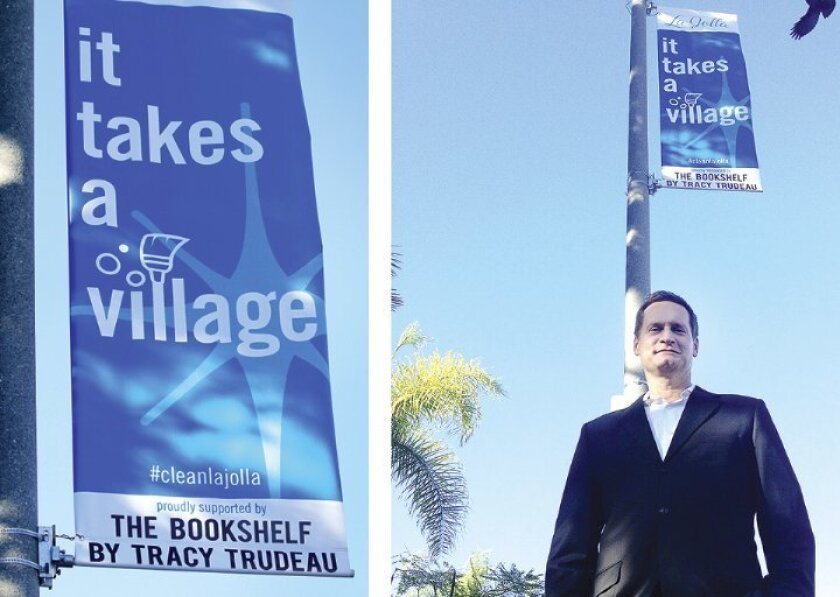 Tracy Trudeau, branch manager of Rancho Financial Mortgage Center on Ivanhoe Avenue, stands by one of two of his Sparkle & Shine banners. This one on Ivanhoe, near Silverado Street, promotes 'The Bookshelf,' a program through which he has committed to donate $10,000 worth of books purchased from Wa