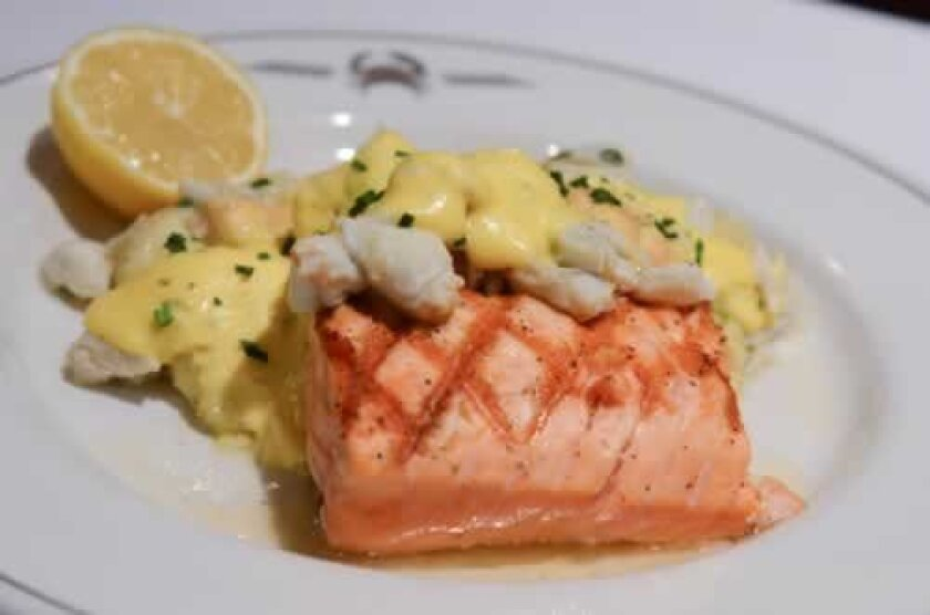 Salmon Bearnaise on a bed of parmesan mashed potatoes. The fish is topped with Laughing Bird Shrimp and jumbo lump blue crab. Photos by Kelley Carlson